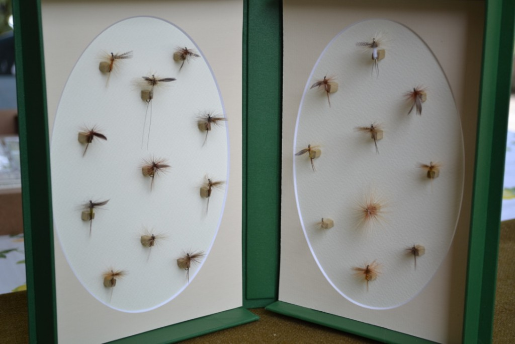 Catskill style dry flies on oval mat board